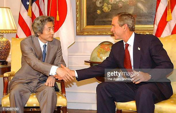 Japanese Prime Minister Junichiro Koizumi and US President George W Bush shake hands prior to their meeting on September 12 2002 in New York City
