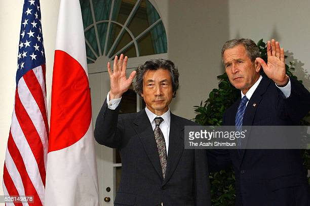 Japanese Prime Minister Junichiro Koizumi and US President George W Bush attend a joint press conference following their meeting at the White House...