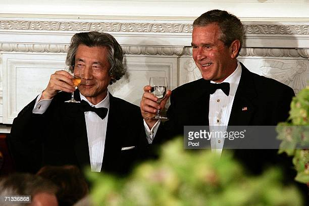 Japanese Prime Minister Junichiro Koizumi and U.S. President George W. Bush drink a toast before a state dinner at the White House June 29, 2006 in...