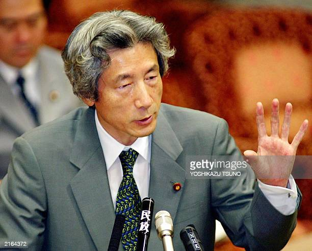 Japanese Prime Minister Junichiro Koizumi answers a question during the Upper House's financial committee session at the National Diet in Tokyo 15...