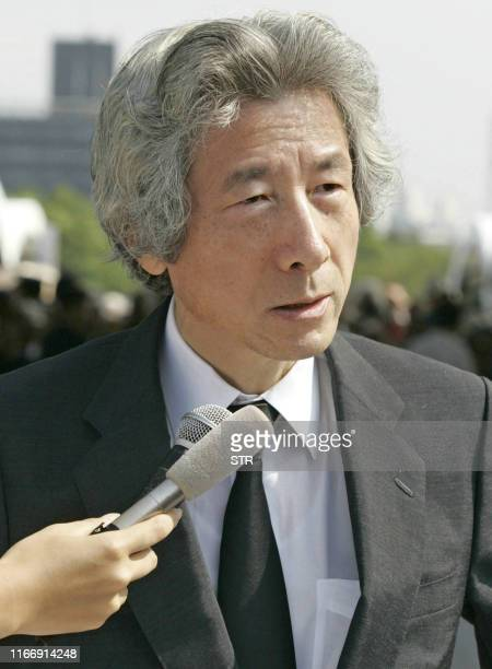 Japanese Prime Minister Junichiro Koizumi answers questions to the press after the 60th Hiroshima Peace Memorial Ceremony in Hiroshima western Japan...