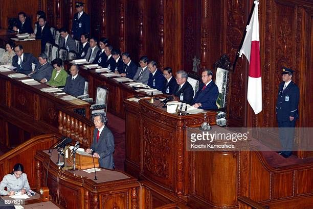 Japanese Prime Minister Junichiro Koizumi delivers his first major policy speech of the year at the upper house of Parliament February 4 2002 in...