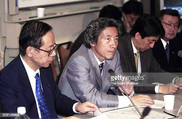 Japanese Prime Minister Junichiro Koizumi directs staffs to respond the September 11 terrorist attack in the United States at his offical residence...