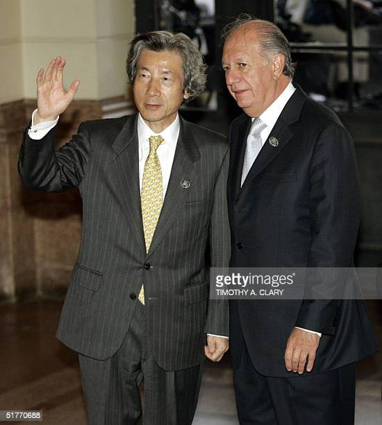 Japanese Prime Minister Junichiro Koizumi is greeted by Chilean President Ricardo Lagos upon his arrival at the Estacion Mapocho Cultural Center...
