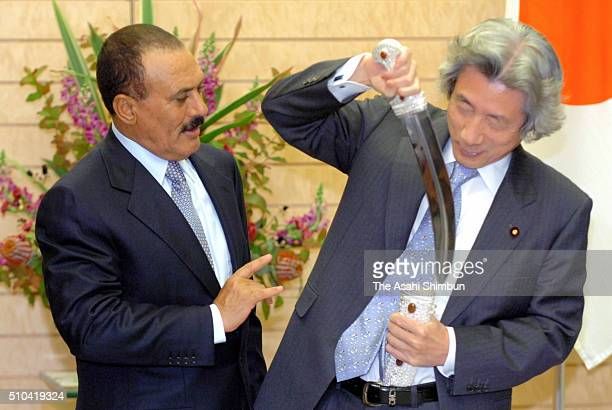 Japanese Prime Minister Junichiro Koizumi is presented a knife from Yemen President Ali Abdullah Saleh during their meeting at Koizumi's official...