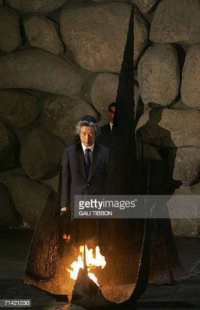 Japanese Prime Minister Junichiro Koizumi lights the Eternal Flame at the Remembrance Hall during his visit to the Yad Vashem Holocaust Museum in...