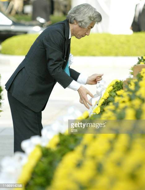 Japanese Prime Minister Junichiro Koizumi offers a flower wreath to the altar of the atomic bomb victims during the 60th Hiroshima Peace Memorial...