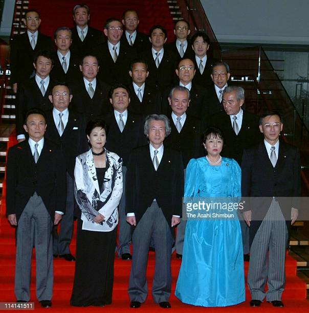 Japanese Prime Minister Junichiro Koizumi poses for photographers together with other members of the cabinet at the Prime Minister's official...