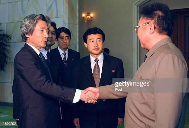 Japanese Prime Minister Junichiro Koizumi shakes hands with North Korean leader Kim Jongil prior to their summit talks at the Paekhwawon state...