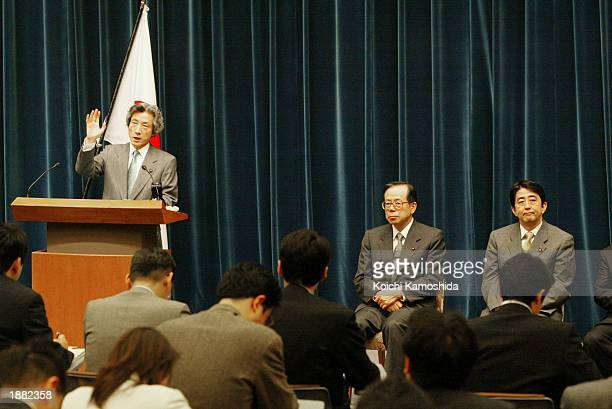 Japanese Prime Minister Junichiro Koizumi speaks during a media conference while Chief Cabinet Secretary Yasuo Fukuda , and Deputy Chief Cabinet...