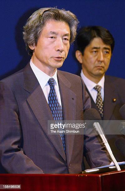 Japanese Prime Minister Junichiro Koizumi speaks while vice cabinet secretary Shinzo Abe listens after Japan and North Korea signed Pyongyang...