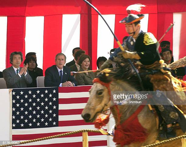 Japanese Prime Minister Junichiro Koizumi United States President George W Bush and his wife Laura Bush watch a Yabusame horseback archery at the...