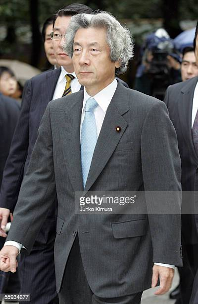 Japanese Prime Minister Junichiro Koizumi walks at Yasukuni Shrine on October 17 2005 in Tokyo Japan Koizumi visited the warlinked shrine that...
