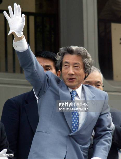 Japanese Prime Minister Junichiro Koizumi waves to supporters to start his first stumping tour since he dissolved the House of Representatives in...
