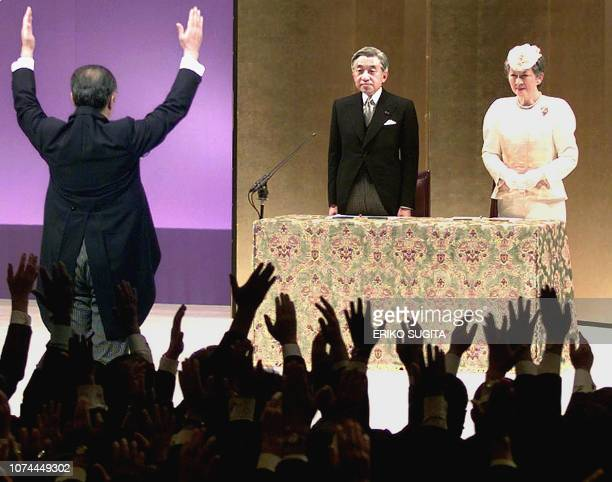 Japanese Prime Minister Keizo Obuchi raises his arms as he shouts 'Long live the Emperor' to Emperor Akihito of Japan accompanied by Empress Michiko...