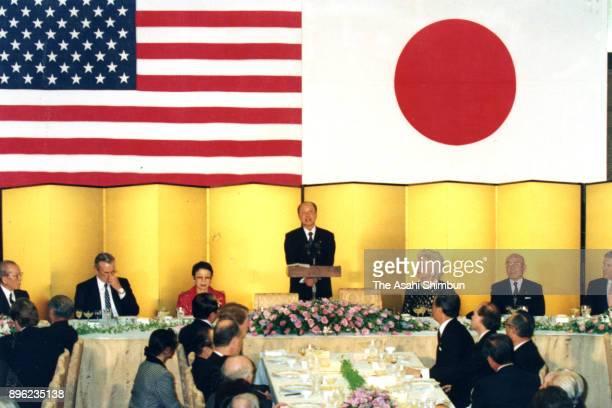 Japanese Prime Minister Kiichi Miyazawa addresses with the absence of US President George Bush as he fell at the dinner at the prime minister's...
