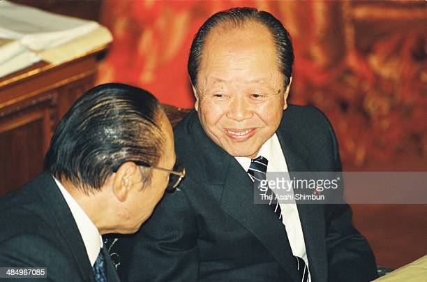 Japanese Prime Minister Kiichi Miyazawa speaks to vice Prime Minister Michio Watanabe during an upper house plenary session of the diet on Janaury 22...