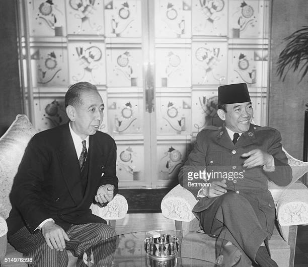 Japanese Prime Minister Kishi Nobusuke greets Indonesian President Sukarno during a state visit in Tokyo Japan