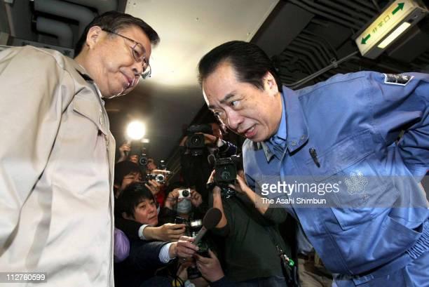 Japanese Prime Minister Naoto Kan bows to Fukushima Prefecture Govenor Yuhei Sato prior to their meeting at Fukushima Prefecuture Government...