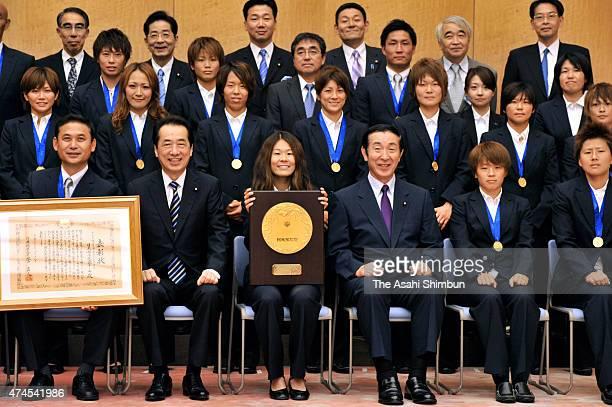 Japanese Prime Minister Naoto Kan , Education Minister Yoshiaki Takagi , head coach Norio Sasaki , captain Homare Sawa , Aya Miyama and members of...