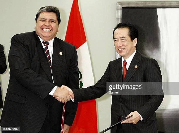 Japanese Prime Minister Naoto Kan shakes hands with Peruvian President Alan Garcia at their bilateral meeting during the 18th AsiaPacific Economic...