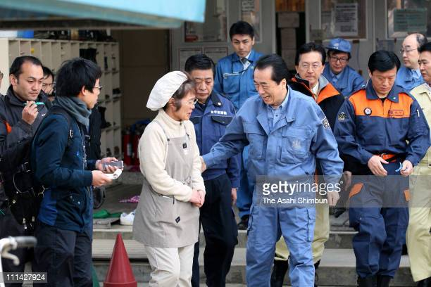 Japanese Prime Minister Naoto Kan speaks to an evacuee at an evacuation center on April 2 2011 in Rikuzentakata Iwate Japan More than three weeks...