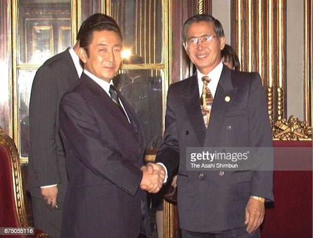 Japanese Prime Minister Ryutaro Hashimoto shakes hands with Peruvian President Alberto Fujimori prior to their meeting at the presidential palace on...