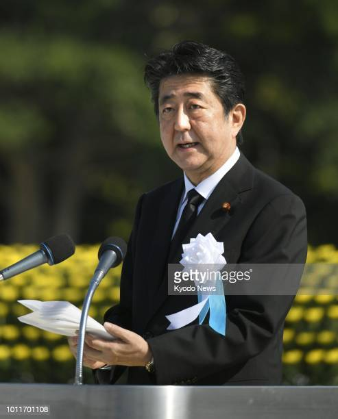 Japanese Prime Minister Shinzo Abe addresses a ceremony marking the 73rd anniversary of the US atomic bombing of Hiroshima at the Peace Memorial Park...