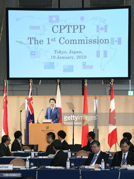 Japanese Prime Minister Shinzo Abe addresses a meeting of the 11 countries taking part in the TransPacific Partnership free trade accord in Tokyo on...