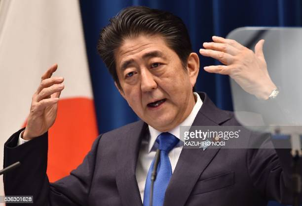 Japanese Prime Minister Shinzo Abe addresses a press conference at his official residence in Tokyo on June 1 2016 Abe said he would delay a...