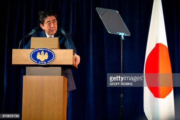 Japanese Prime Minister Shinzo Abe addresses a press conference at the conclusion of the G7 Summit in La Malbaie Canada on June 9 2018 The leaders of...