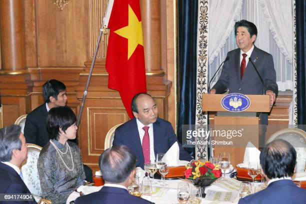 Japanese Prime Minister Shinzo Abe addresses during a dinner with Vietnamese Prime Minister Nguyen Xuan Phuc at his official residence on June 6 2017...