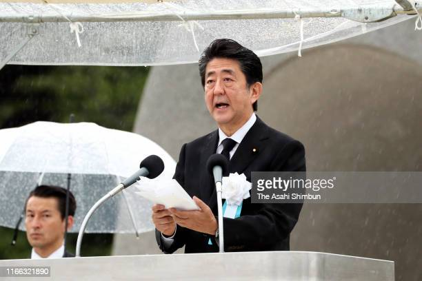 Japanese Prime Minister Shinzo Abe addresses during the Peace Memorial Ceremony on the 74th anniversary of the atomic bombing of Hiroshima at the...