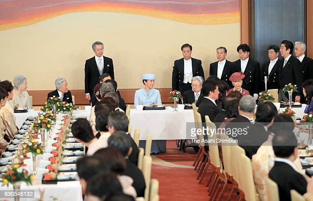 Japanese Prime Minister Shinzo Abe addresses to celebrate the 83rd birthday of Emperor Akihito during a banquet at the Imperial Palace on December 23...