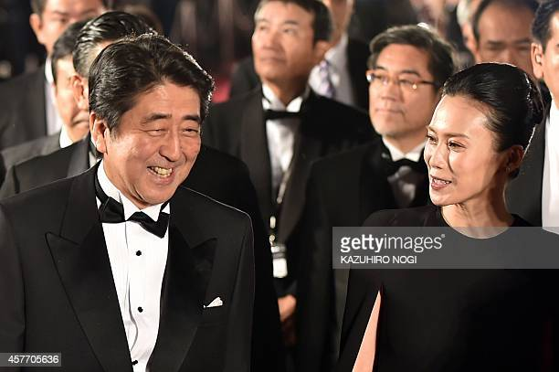 Japanese Prime Minister Shinzo Abe and actress Miki Nakatani walk on the red carpet for the 27th Tokyo International Film Festival opening ceremony...