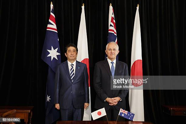 Japanese Prime Minister Shinzo Abe and Australian Prime Minister Malcom Turnbull attend a joint signing ceremony at the completion of bilateral talks...