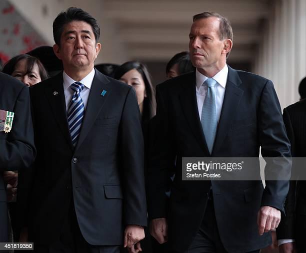 Japanese Prime Minister Shinzo Abe and Australian Prime Minister Tony Abbott inspect the World War 1 cloisters at the Australian War Memorial on July...