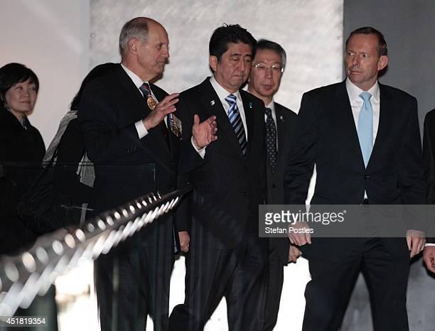 Japanese Prime Minister Shinzo Abe and Australian Prime Minister Tony Abbott inspect the Australian War Memorial on July 8 2014 in Canberra Australia...