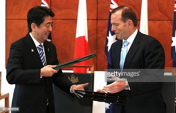 Japanese Prime Minister Shinzo Abe and Australian Prime Minister Tony Abbott shake hands after signing the JapanAustralia Economic Partnership...