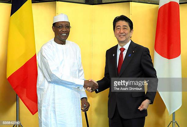 Japanese Prime Minister Shinzo Abe and Chad President Idriss Deby Itno shake hands prior to their meeting on May 28 2016 in Nagoya Japan Abe holds a...