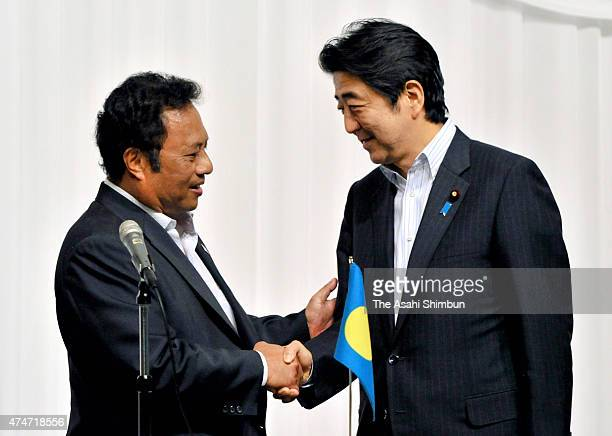Japanese Prime Minister Shinzo Abe and cochair and Palau President Tommy Remengesau shake hands after a joing press conference during the Pacific...
