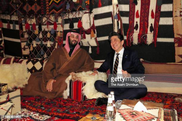Japanese Prime Minister Shinzo Abe and Crown Prince Mohammad bin Salman of Saudi Arabia talk during their meeting on January 12 2020 in AlUla Saudi...