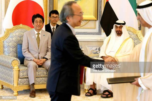 Japanese Prime Minister Shinzo Abe and Crown Prince of Abu Dhabi Sheikh Mohamed bin Zayed Al Nahyan attend the signing ceremony on April 30 2018 in...
