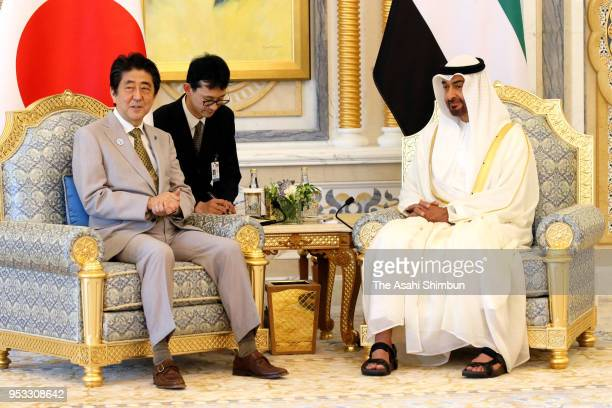 Japanese Prime Minister Shinzo Abe and Crown Prince of Abu Dhabi Sheikh Mohamed bin Zayed Al Nahyan talk during their meeting on April 30 2018 in Abu...
