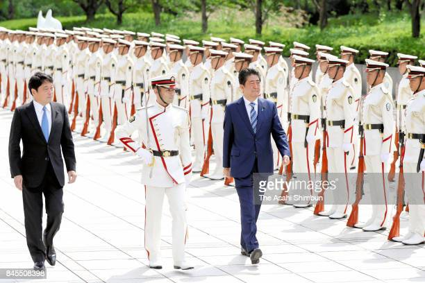 Japanese Prime Minister Shinzo Abe and Defense Minister Itsunori Onodera review the honour guard during the meeting of the Japan SelfDefense Force...