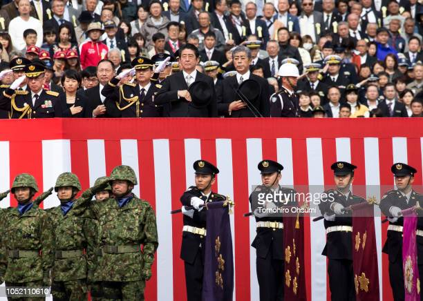 Japanese Prime Minister Shinzo Abe and Defense Minister Takeshi Iwaya review troops of the country's Self Defense Forces during the annual review at...