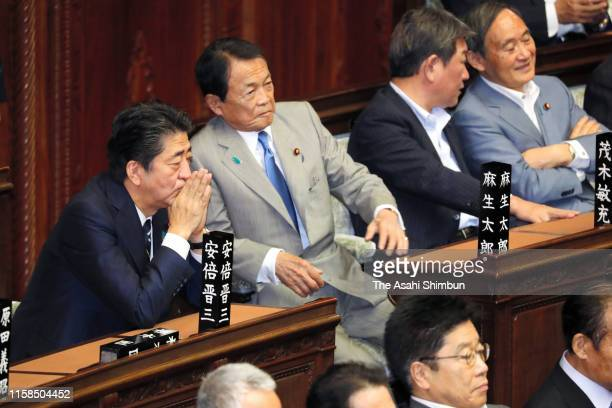 Japanese Prime Minister Shinzo Abe and Deputy Prime Minister Taro Aso attend a lower house plenary session as the 198th ordinary session of diet ends...