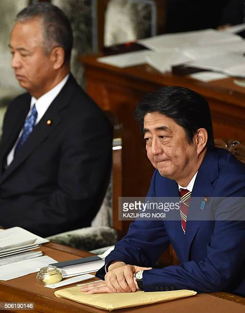 Japanese Prime Minister Shinzo Abe and Economy and Fiscal Policy Minister Akira Amari attend a plenary session of the House of Representatives at the...