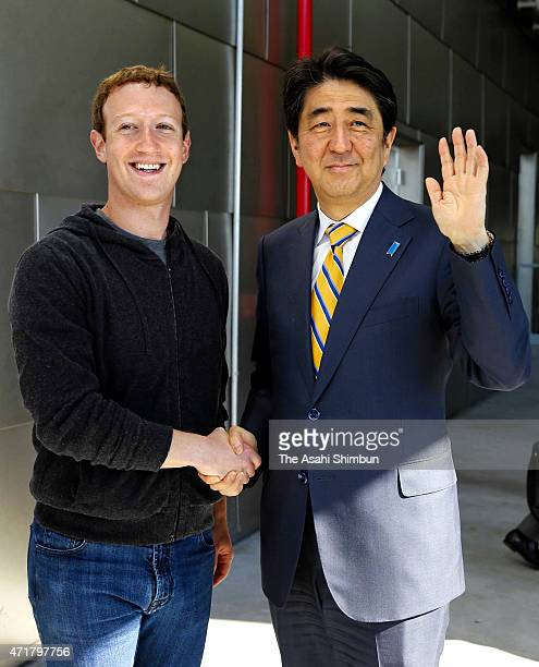 Japanese Prime Minister Shinzo Abe and Facebook CEO Mark Zuckerberg shake hands as Abe visits Facebook headquarters on April 30 2015 in Menlo Park...