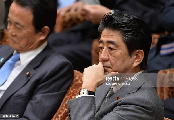 Japanese Prime Minister Shinzo Abe and Finance Minister Taro Aso attend a budget committee session of the House of Representatives at the Diet in...